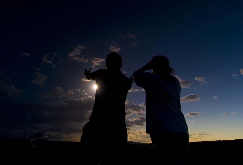 Irish eclipse chasers Daniel Lynch and Mary Dobbs welcome the shadow of the Moon. Published in Total Addiction (2012)